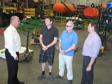 Ausplow's Chris Farmer (left) and Chris Blight, flank French farmer Guillaume Renault and Belgium precision farming dealer and tour leader Pol Braine during the recent factory tour by a group of European farmers to Ausplow's Jandakot factory.