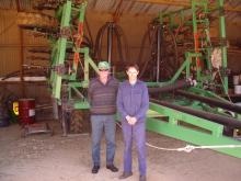 Ross Whittall and his nephew James Lewis who helped run the farm with Ross when this picture was taken in 2003 by Farm Weekly. In the background is DBS 001.
