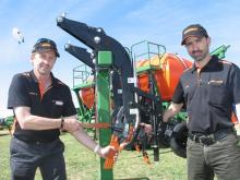 Ausplow marketing manager Chris Blight (left) shows how to remove a DBS blade with an extraction tool which also is used to lock the whole assembly in place. With him is Ausplow engineering manager Carl Vance who played a pivotal role in developing the Pro-D tillage tool system.