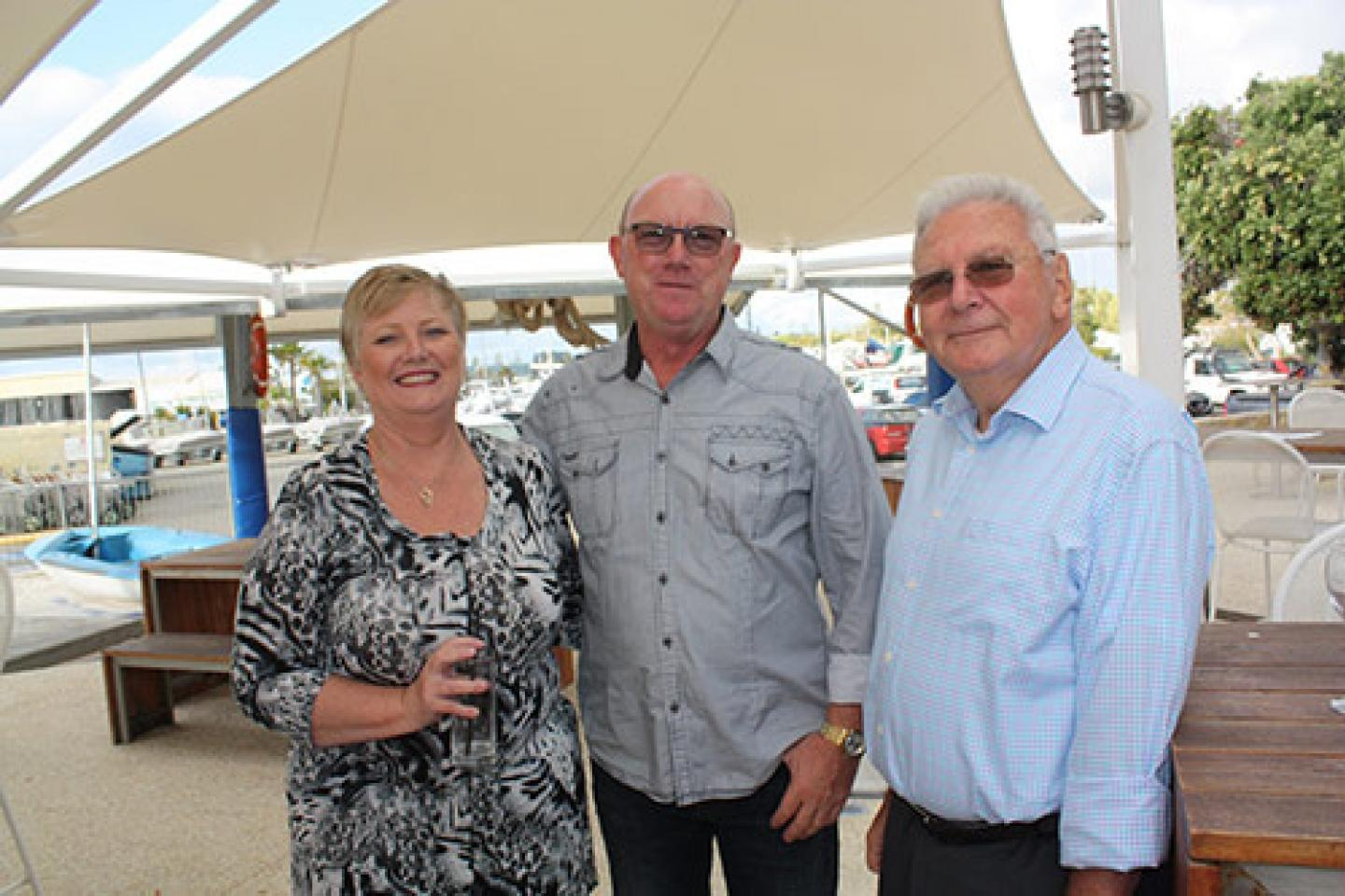 Ausplow Service Technician Dave Finlay (left), his partner Kady and Ausplow Managing Director John Ryan.