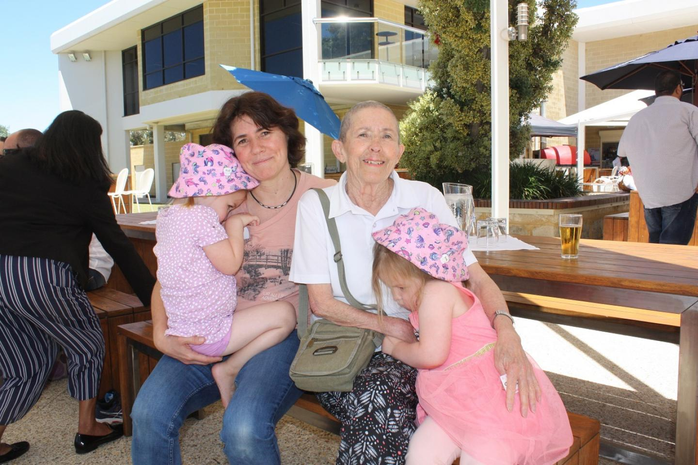 Ausplow engineering manager Carol Erasmus (left) and her mother Melody were kept busy with Carol's daughters Aria (left) and Carley, who didn't want their photograph taken.