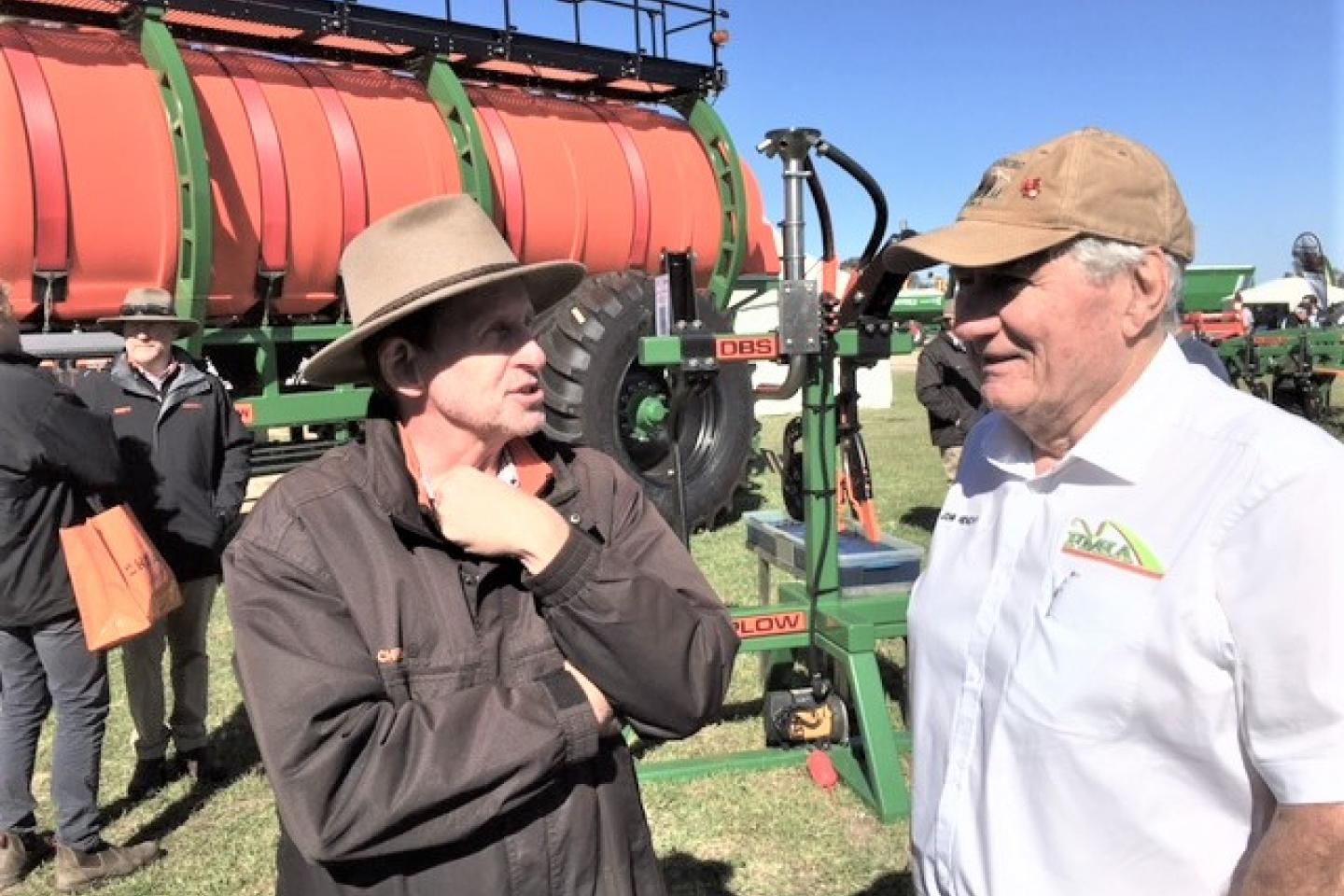 Ausplow sales and marketing manager Chris Blight (left) caught up with Farm Machinery & Industry Association executive director John Henchy at the Ausplow display.