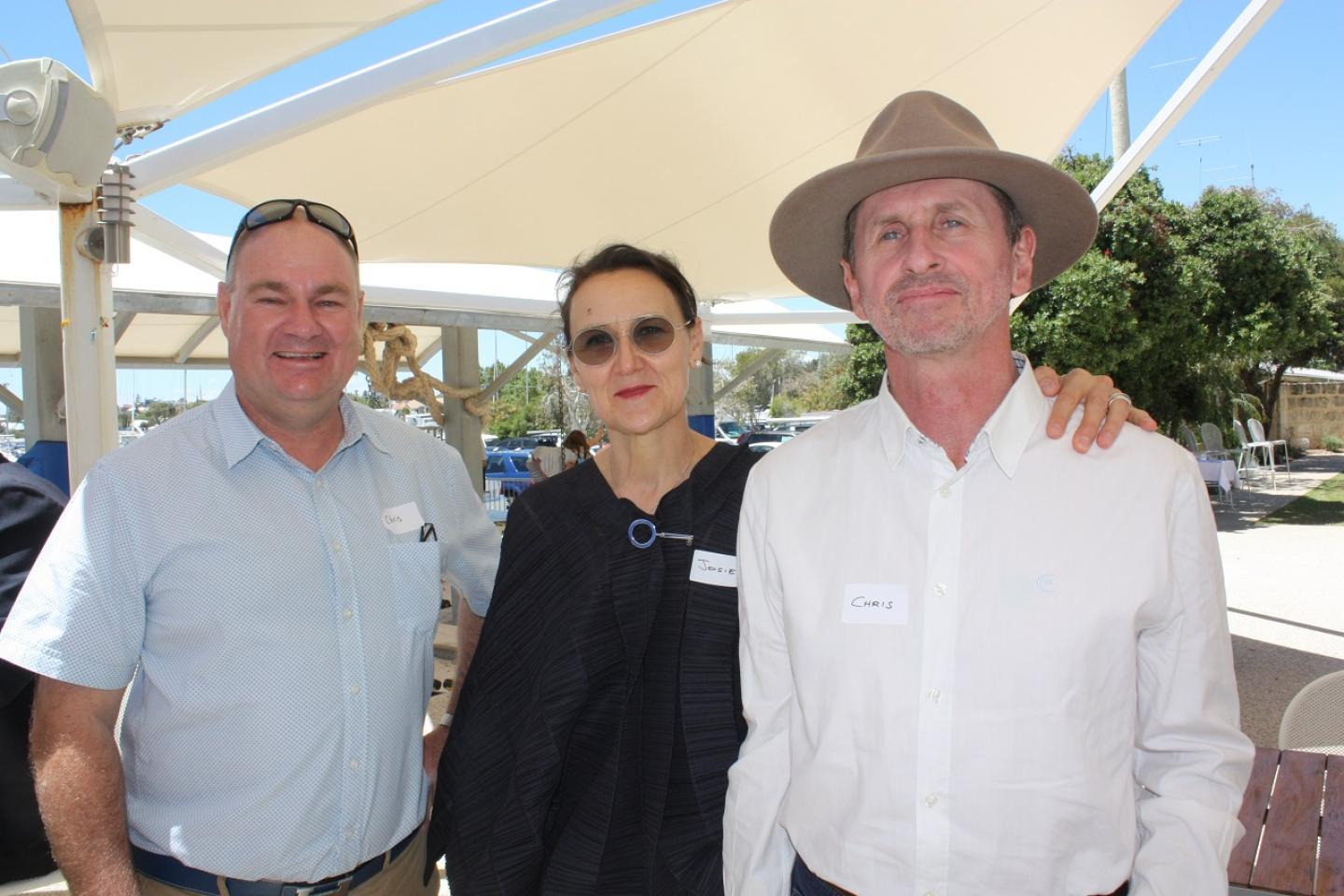Ausplow general manager Chris Farmer (left) and marketing and sales manager Chris Blight flank Chris Blight's partner Josianne 'Josie' Sabouriaut.