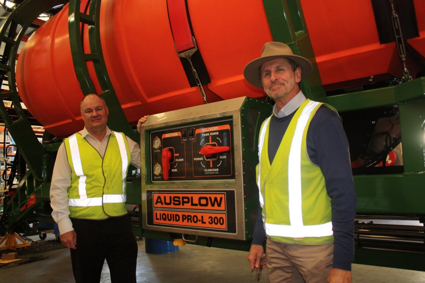 Ausplow general manager Chris Farmer (left), and company sales and marketing manager Chris Blight, in front of the new stainless steel-housed liquid work station mounted on the new Multistream liquid-ready air seeder.