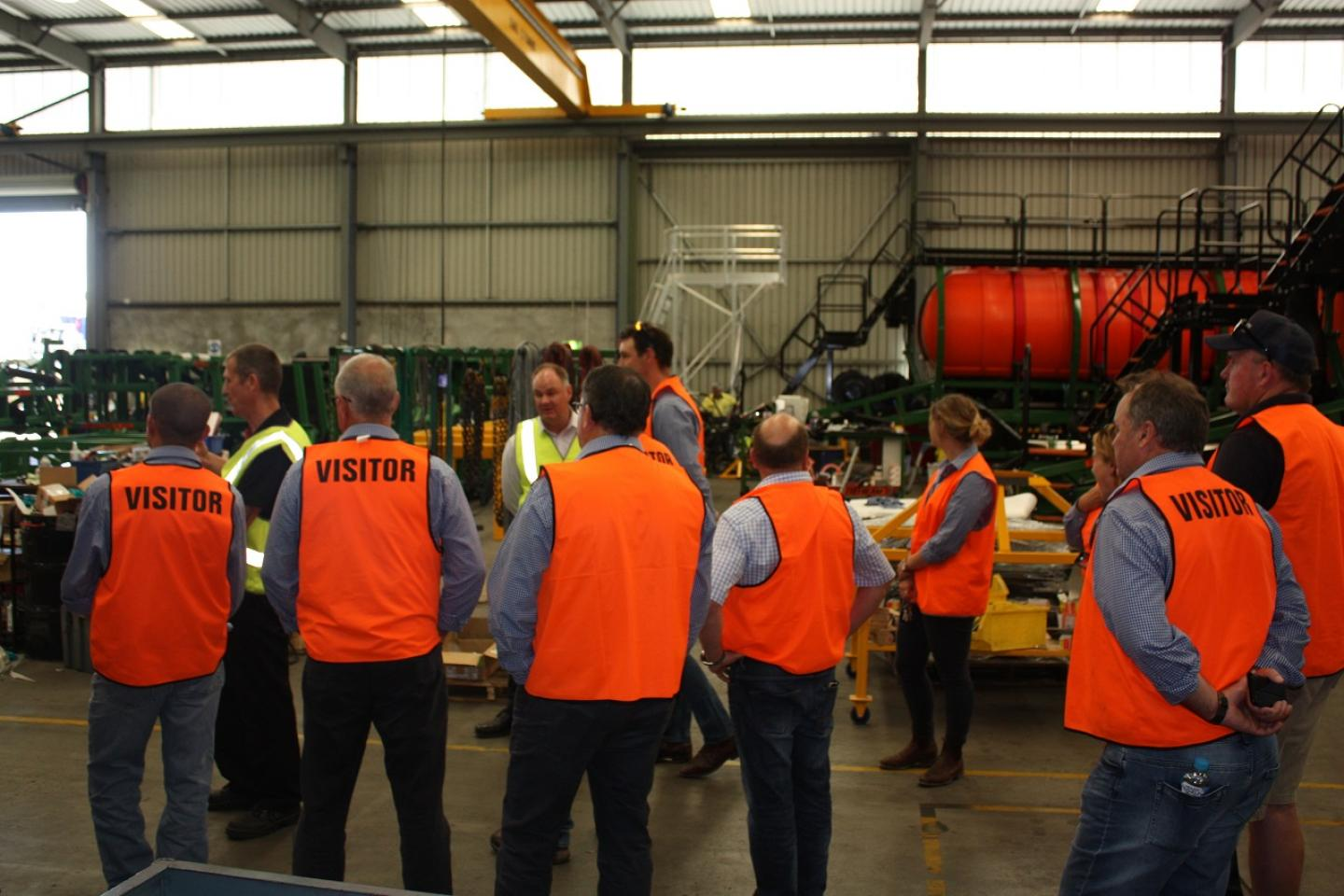 Ausplow production manager Gary Andrews (centre left) and company general manager Chris Farmer explain the production processes to Primaries CRT agronomists during a factory tour that included visiting the company's Jandakot and Naval Base factories.