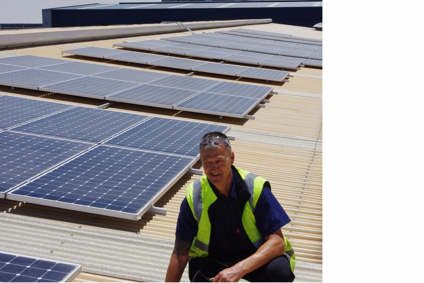 Ausplow operations manager at Naval Base, Gary Andrews, checks out the recently-installed solar panels on the roof of the main factory.