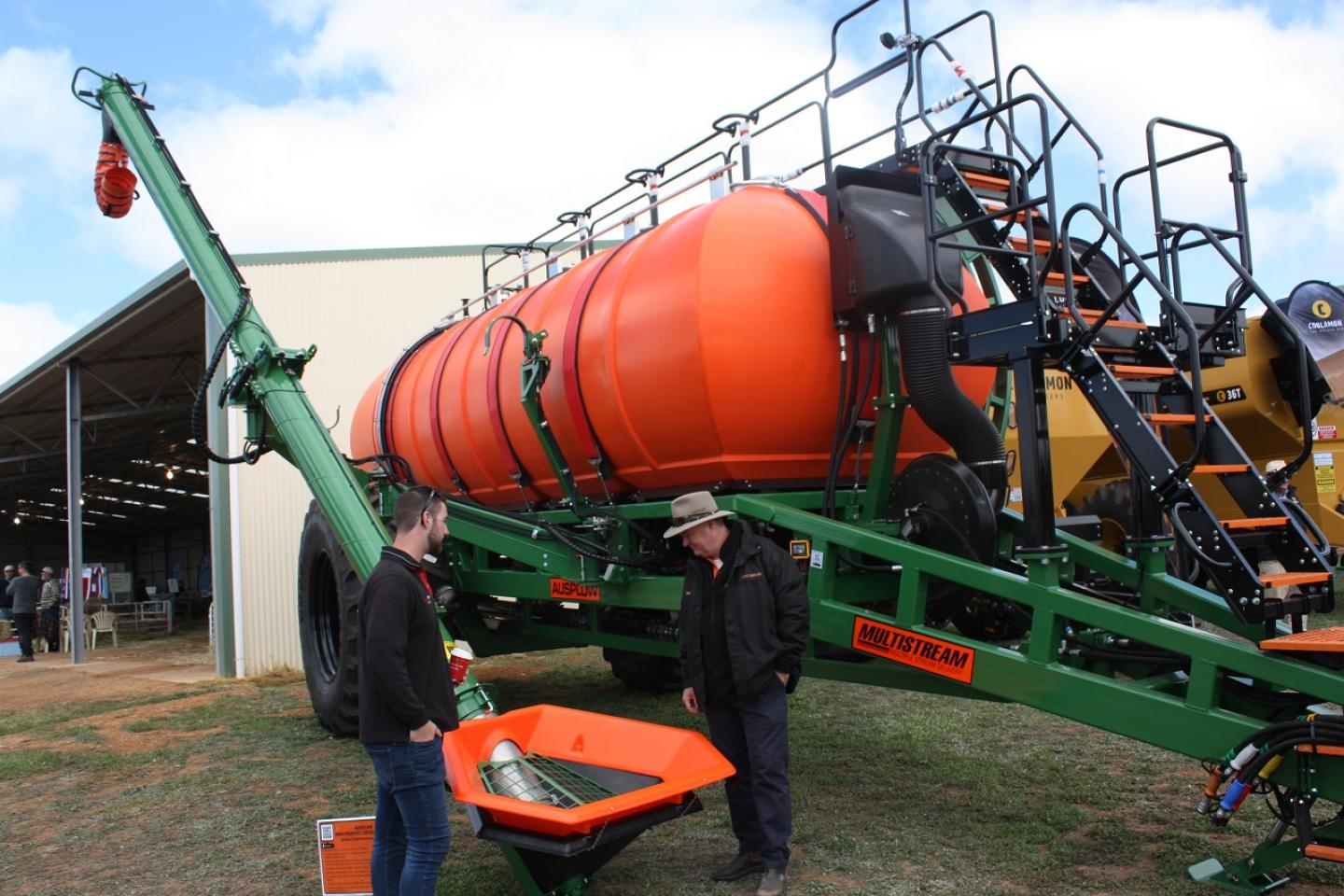 Farmers Centre Esperance salesman Jakke Little (left) is taken on a walk-round of the Series II Multistream at the Newedegate Machinery Field Days earlier this month by Ausplow general manager Chris Farmer. Significant changes have been made for 2019 models.