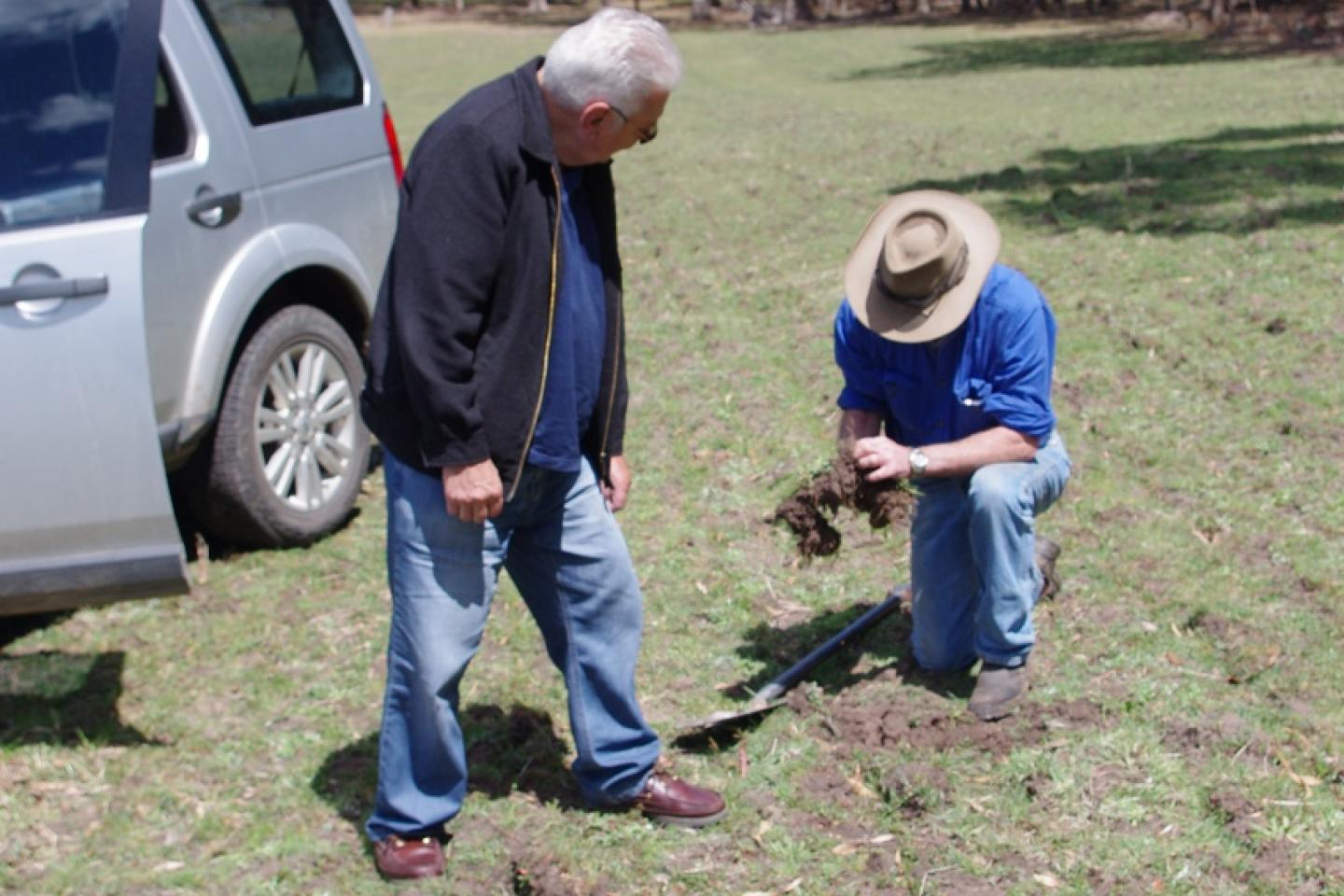 Ausplow Managing Director John Ryan (eft) and Peter Alexander busy digging holes to check soil structure in one of the paddocks Peter is trialling the DBS.