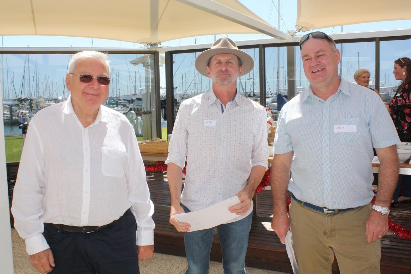 Ausplow sales and marketing manager Chris Blight (middle) was recognised for his 10 years' service with the company. Flanking him are Managing Director John Ryan AM and General Manager Chris Farmer.