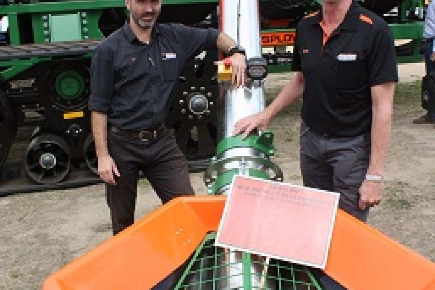 Ausplow engineering manager Carl Vance (left) and Ausplow marketing and sales manager Chris Blight show off the company's new stainless steel auger for the Series II Multistream.