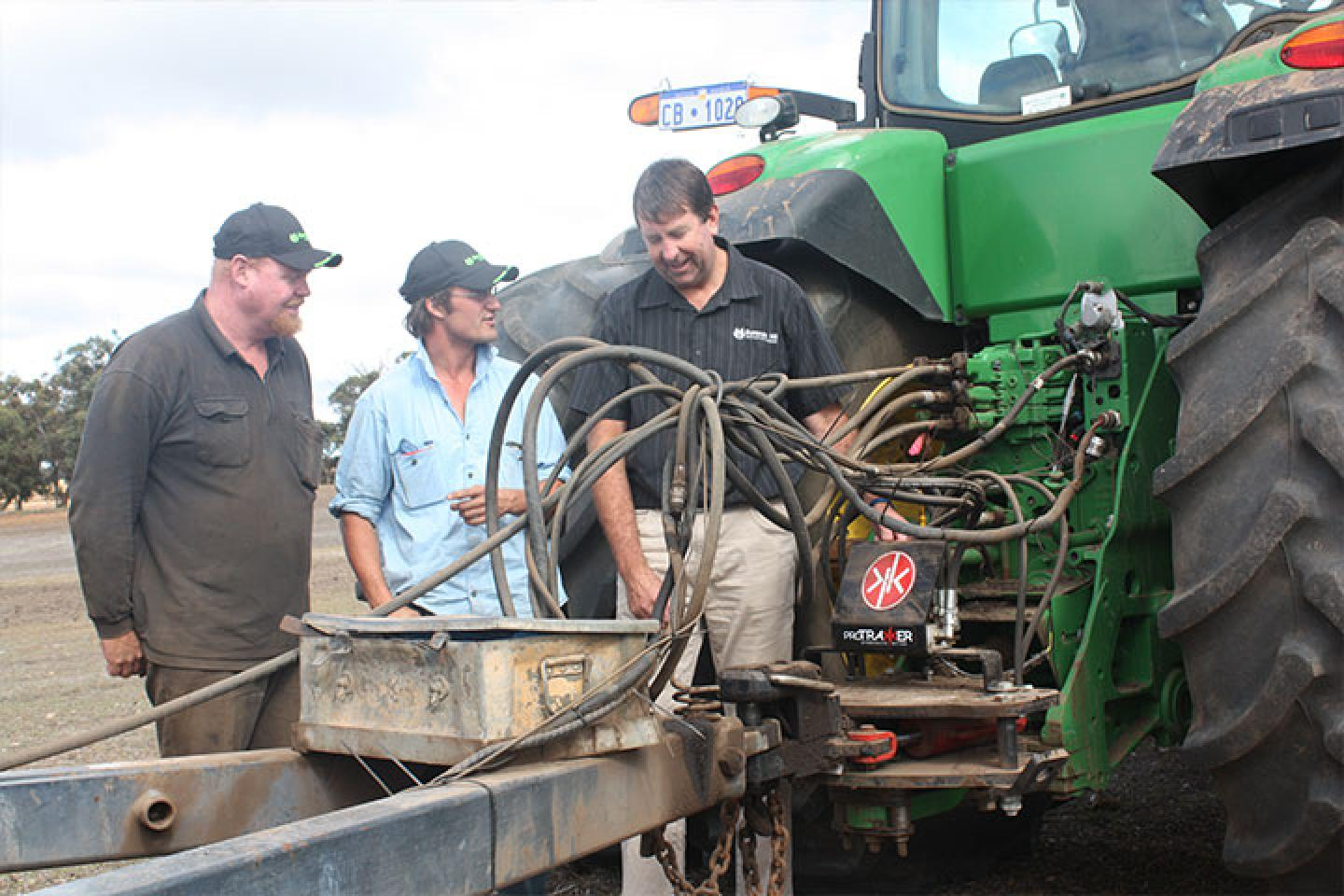 Cranbrook farmer Theo Cunningham (left) and Burando Hill salesman Michael Kowald discuss the hydraulic set-up on the ProTrakker guidance system, which is connected to the Cunningham's DBS precision seeder. It's a system growing in popularity to establish crops in the previous year's rows without disturbing stubble.