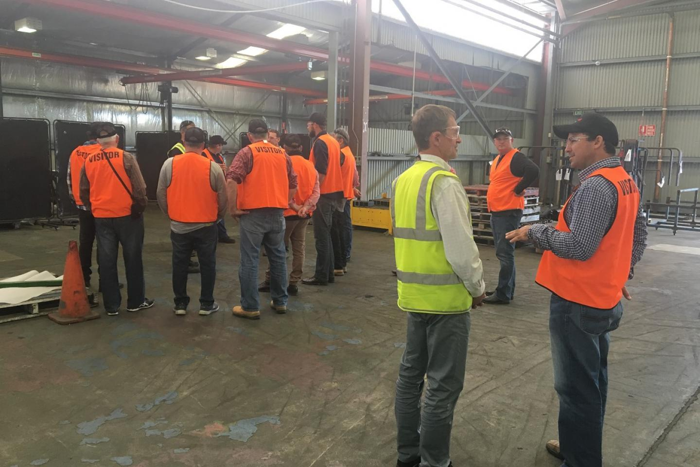 Ausplow sales and marketing manager Chris Blight (yellow safety vest) provided a detailed explanation of the Ausplow DBS precision seeder and an insight into some of the R & D programs Ausplow is involved in.